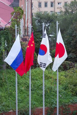 flags of Japan, Russia, China, Republic of Korea on the flagpoles