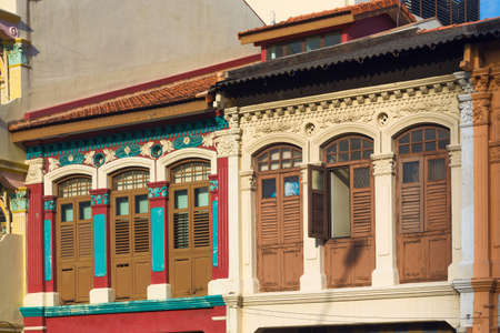 colorful houses with painted Windows and shutters in the historic Little India quarter in Singapore
