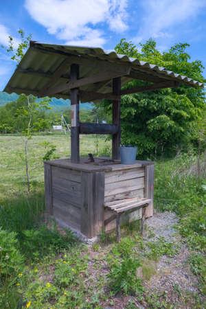 old village well on the farm Foto de archivo