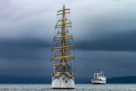 sailboat at anchor in cloudy weather Foto de archivo