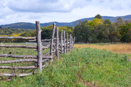wooden fence on a farm in the village