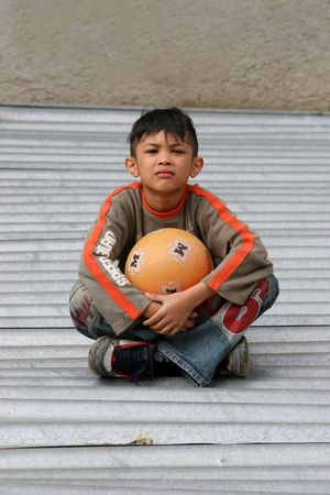 streetlife: small boy with ball