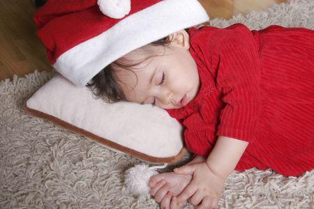 cute baby with santa hat sleeping  photo