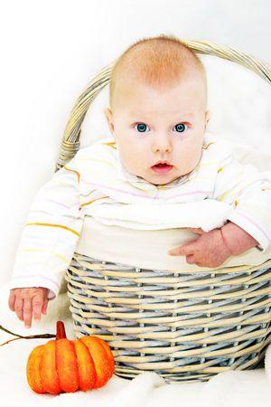 Boy in the autumn basket photo