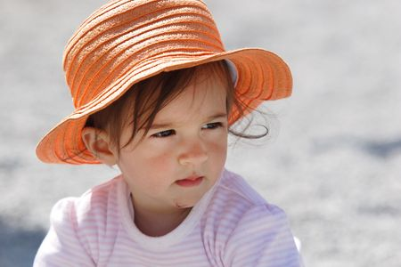 Baby girl  in orange hat photo