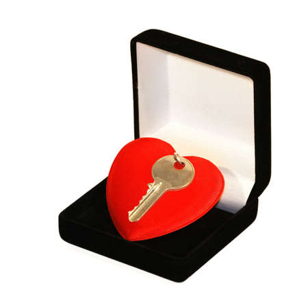 Still key over red heart inside jewelire box photo
