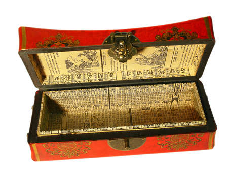 trigram: Open red oriental treasure made from leather, paper and wood with latch