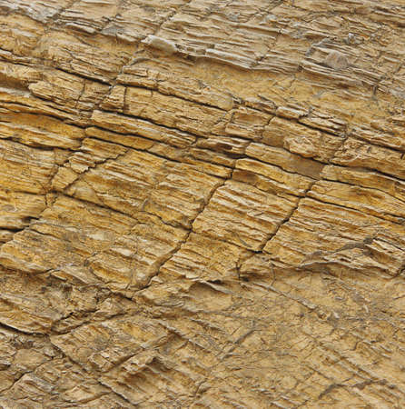 Structured cracked golden texture of stone Stock Photo - 7074091