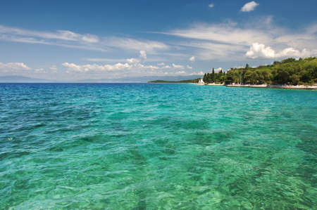 ure: ure, clear sea, blue sky with clouds and a picturesque strip of coast on the horizon Stock Photo