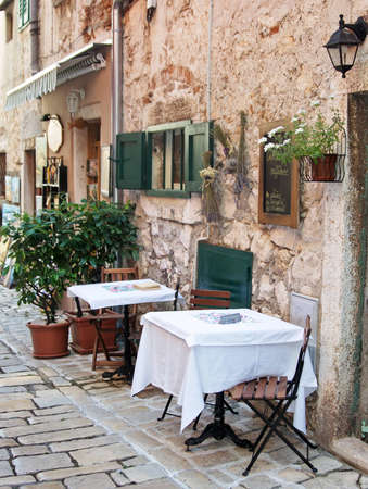 Street cafe in old town Rovinj, istria, Croatia photo