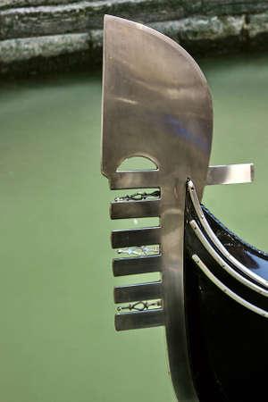 ferro: Gondolas ferro against the background of the shore of the narrow channel