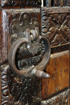 An old knocker on the wooden carved gates, photographed in Venice Stock Photo - 13022947