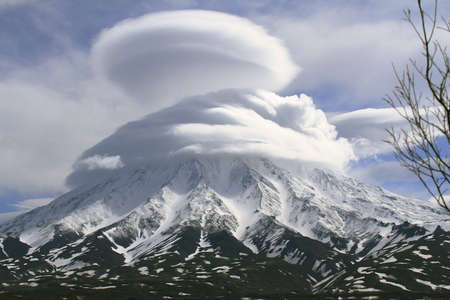 dormant: Kronotsky volcano in the  houve of the clouds, Kamchatka, Russia Stock Photo