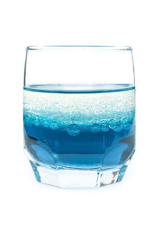 glass with blue liquid and bubbles of oil on a white background Stock Photo - 6385259
