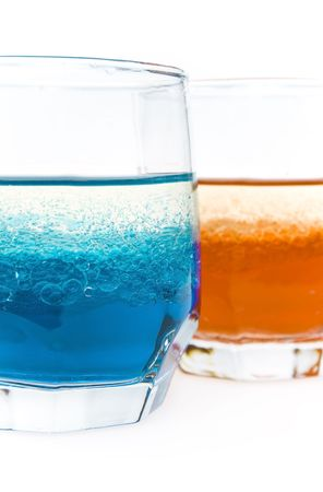 two glass with red and blue liquid and bubbles of oil on a white background Stock Photo - 6385262