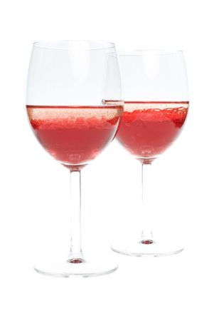 two wineglass with colored red liquid and with bubbles of oil on a white background Stock Photo - 6438649
