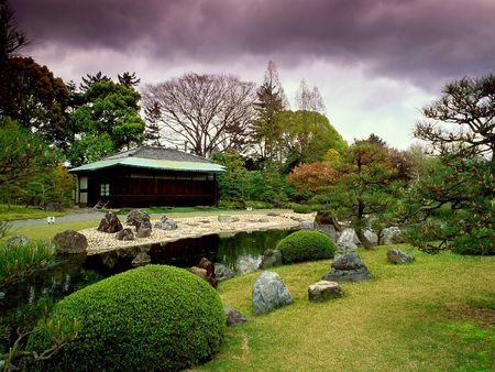 streamlet: Beautiful garden in Japan before a rain, a combination of dark clouds and light horizon