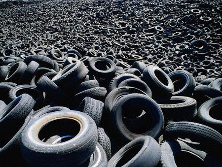 A huge number of old tires. A huge number of old tires. Stock fotó
