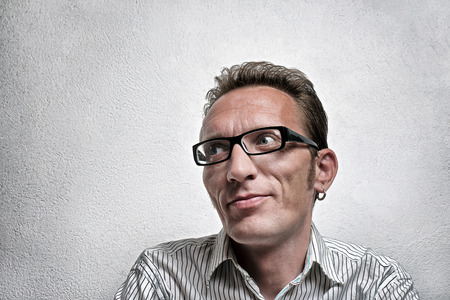 flattery: Close up portrait quit satisfied man with eyeglasses looking left and up with flirty flattery smile