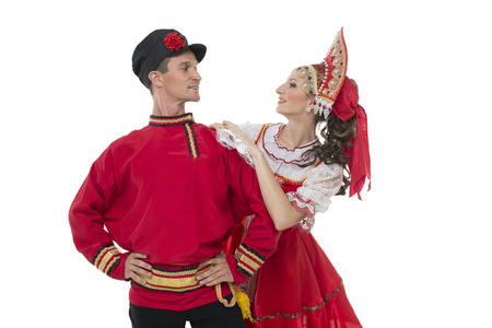 kokoshnik: Conversation young couple in russian traditional costumes, girl in red sarafan and kokoshnik Stock Photo