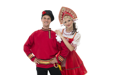 kokoshnik: Portrait of young man and woman looking into the camera in russian traditional costumes Stock Photo