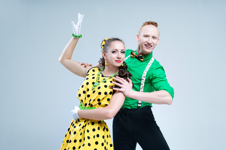 Portrait lovely funny dancer couple dressed in boogie-woogie rock n roll pin up style Standard-Bild