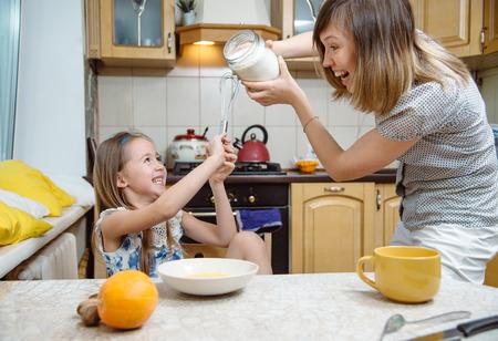little  mothers helper. Small girl going to beat the dough for pancakes Standard-Bild