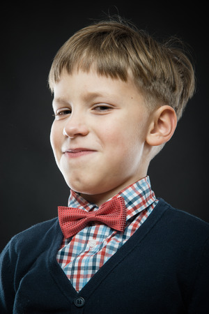 smug: close up portrait of a smiling handsome smug boy