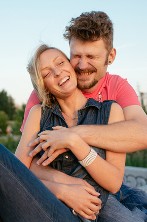 hansome: happy hansome young couple embracing and laughing Stock Photo