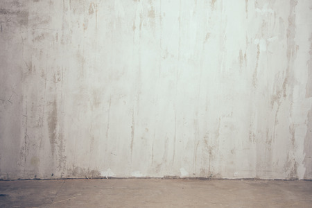 old textured gray wall with the strip of floor
