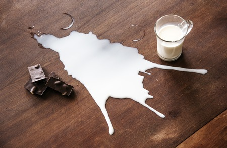 untidiness: Chocolate and spilled milk on the table.Top view. Eco life concept.