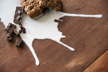 untidiness: Chocolate, bread and spilled milk on the table.Top view. Eco life concept.