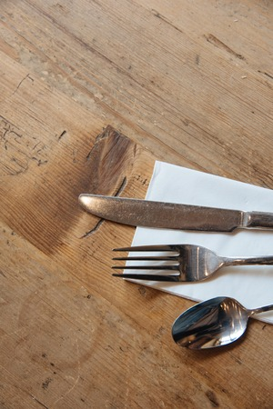 grunge silverware: Set of cutlery on the wooden table. Top view Stock Photo