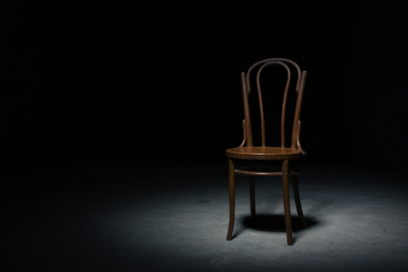 Lonely Chair In The Spot Of Light On Black Background At Empty.. Stock  Photo, Picture And Royalty Free Image. Image 65760623.