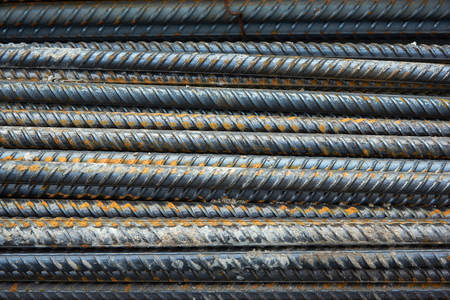 The bars of the rusty steel fittings. Construction of a textured background.