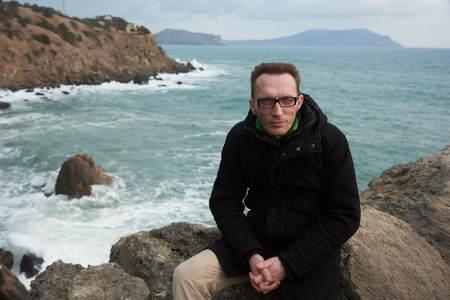 man portrait on the seashore in nice winter day in Crimea