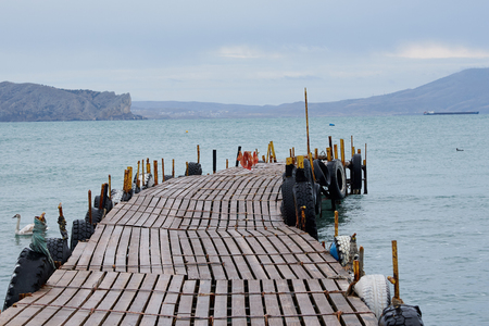 Jetty at Black Sea in Lonely nice winter day