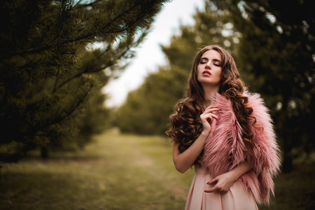 pink fur: Sensual girl with pink fur in forest