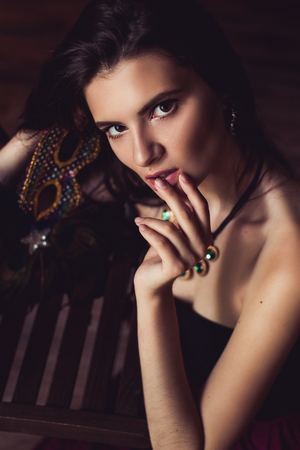 mirow: closeup shot of young brunette model posing in burlesque fitting room Stock Photo