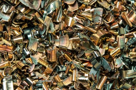 IMetal shavings close-up multicolored. the waste after processing of metal drill to the lathe.