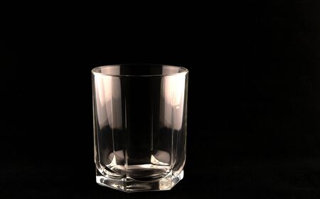 Hexagonal glass for alcoholic beverages on a black background.