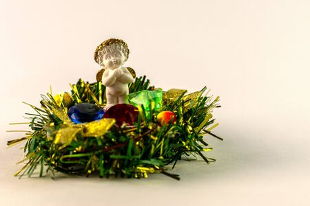 Christmas theme angel in Christmas nest with crystal gifts on snowflake.