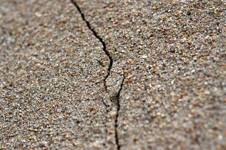 Textured sand plaster, close-up, with a deep crack. Reklamní fotografie