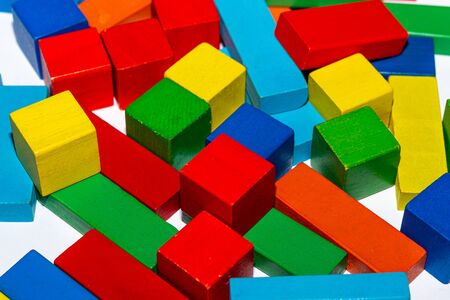 Colorful inexpensive cubes from an orphanage. Wooden cubes for orphaned children.
