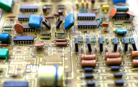 Old vintage printed circuit board with electronic components. Stock fotó