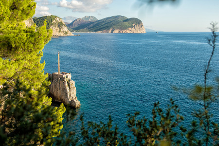 View of the rocky cape in the resort town of Petrovac. Beautiful mediterranean landscape in sunny day, Montenegro. Stock Photo