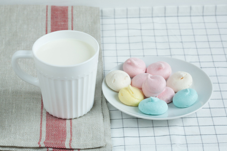 sweettooth: Colored meringue with milk.
