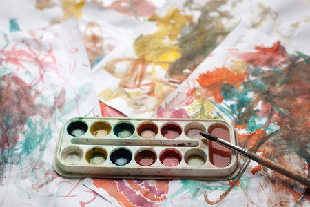 Childrens abstract pattern and palette with brush. Stock Photo
