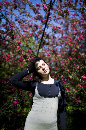 multiple: Portrait of a young beautiful girl in a flowering tree. Beauty of springtime without allergy.