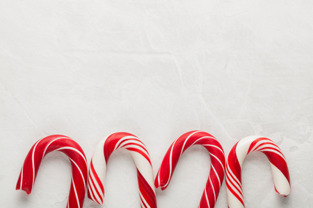 Christmas decors with gray background. Candy cane. Top view with copy space.